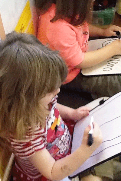 Children drawing pictures at a daycare in Delaware OH