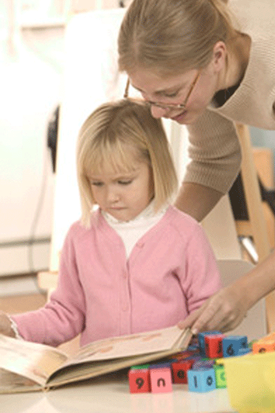 Preschool and daycare education: woman with child